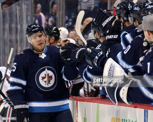 Paul Stastny of the Winnipeg Jets celebrates his first period goal against the Chicago Blackhawks with teammates at the bench at the Bell MTS Place...