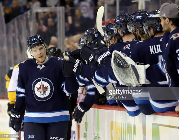 Paul Stastny of the Winnipeg Jets celebrates his third period goal against the Nashville Predators with teammates at the bench at the Bell MTS Place...