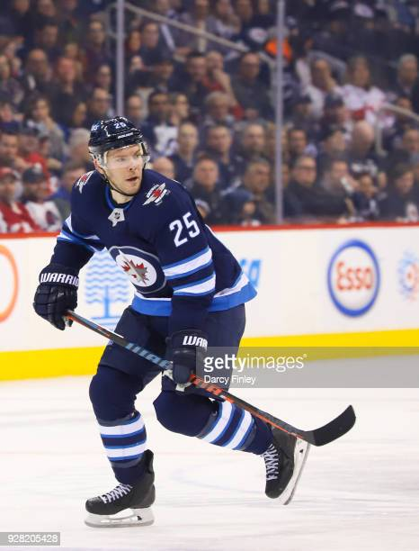 Paul Stastny of the Winnipeg Jets follows the play down the ice during second period action against the Detroit Red Wings at the Bell MTS Place on...