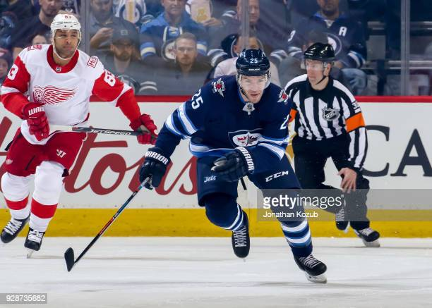 Paul Stastny of the Winnipeg Jets follows the play up the ice during first period action against the Detroit Red Wings at the Bell MTS Place on March...