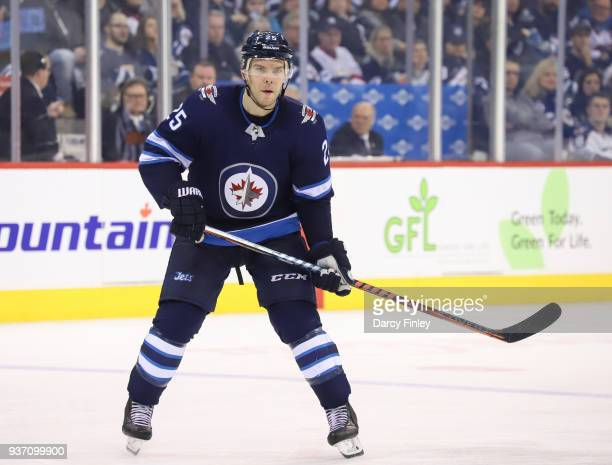 Paul Stastny of the Winnipeg Jets keeps an eye on the play during third period action against the Los Angeles Kings at the Bell MTS Place on March 20...