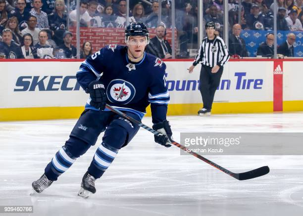 Paul Stastny of the Winnipeg Jets keeps an eye on the play during first period action against the Nashville Predators at the Bell MTS Place on March...