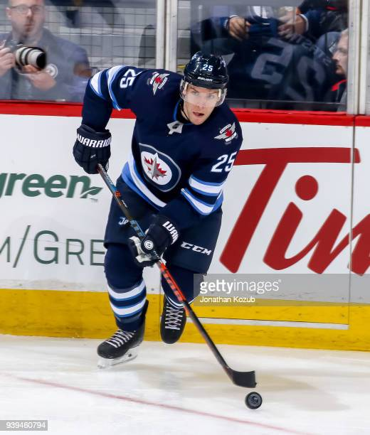 Paul Stastny of the Winnipeg Jets plays the puck during second period action against the Nashville Predators at the Bell MTS Place on March 25 2018...