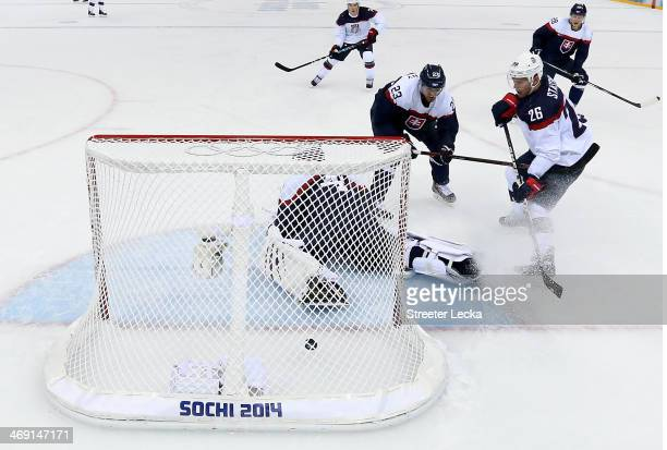 Paul Stastny of United States scores a goal against Jaroslav Halak of Slovakia in the second period during the Men's Ice Hockey Preliminary Round...