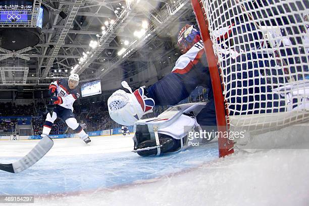 Paul Stastny of United States scores a goal against Jaroslav Halak of Slovakia during the Men's Ice Hockey Preliminary Round Group A game on day six...