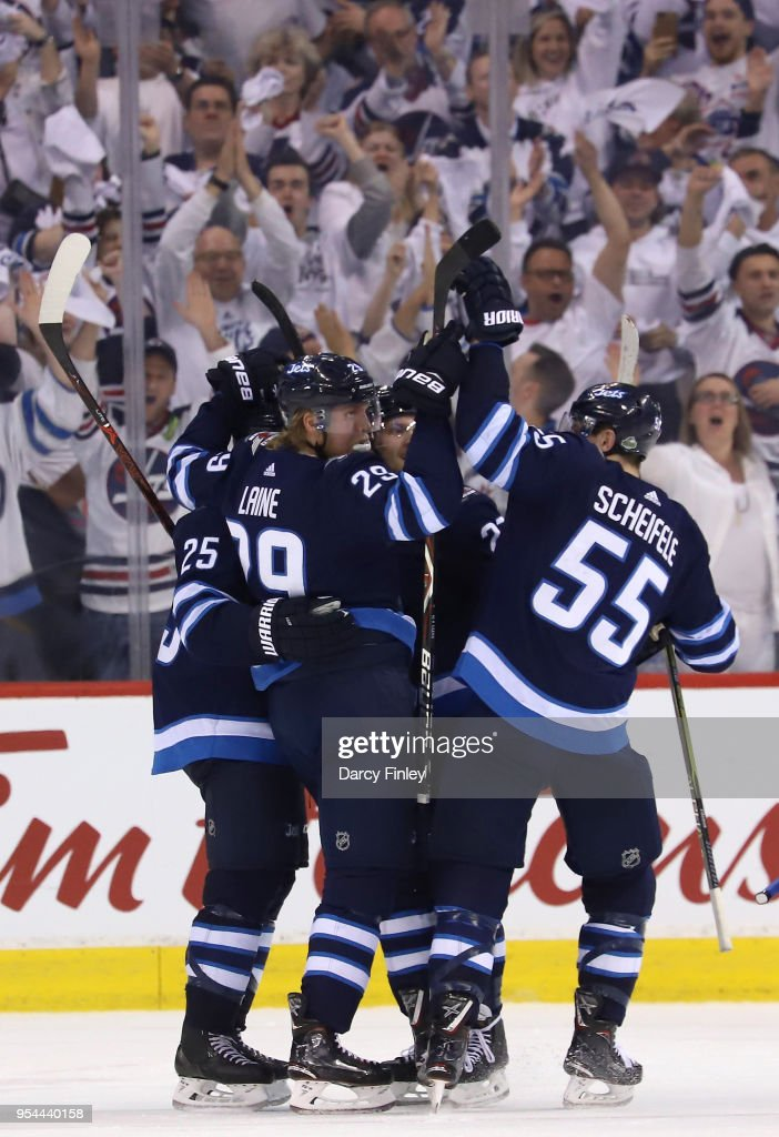 Paul Stastny #25, Patrik Laine #29, Nikolaj Ehlers #27 and Mark Scheifele #55 of the Winnipeg Jets celebrate a third period goal against the Nashville Predators in Game Four of the Western Conference Second Round during the 2018 NHL Stanley Cup Playoffs at the Bell MTS Place on May 3, 2018 in Winnipeg, Manitoba, Canada.