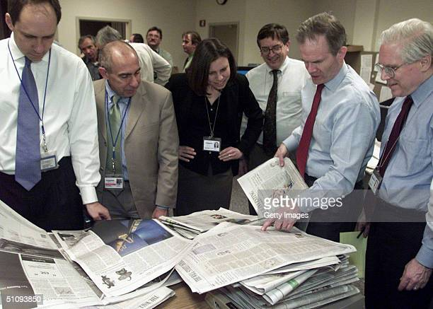 Paul Steiger Managing Editor Of The Wall Street Journal Examines One Of The First Copies Of The Redesigned Newspaper Next To Other Editors In The...