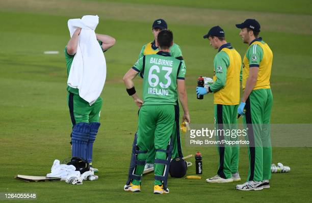Paul Stirling dries his head during a drinks break with Andrew Balbirnie during the third oneday international against England at the Ageas Bowl on...