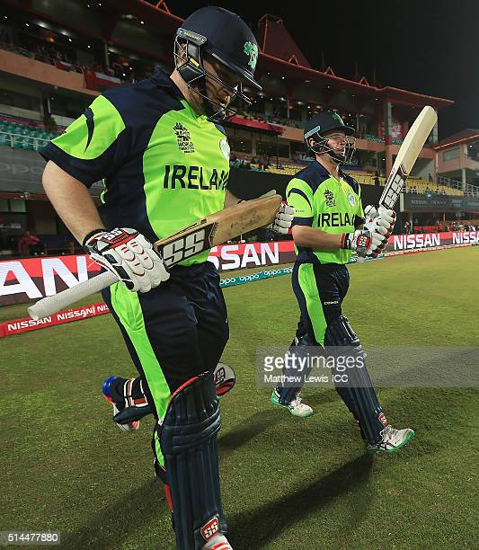 Paul Stirling of Ireland and William Porterfield Captain of Ireland take to the field during the ICC Twenty20 World Cup match between Ireland and...
