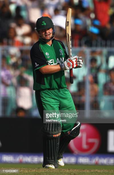 Paul Stirling of Ireland celebrates his century during the 2011 ICC World Cup match between Ireland and Netherlands at Eden Gardens on March 18 2011...