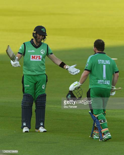 Paul Stirling of Ireland celebrates reaching his century with Andrew Balbirnie during the Third One Day International between England and Ireland in...