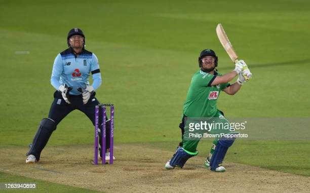 Paul Stirling of Ireland hits out watched by Jonny Bairstow of England during the third one-day international against England at the Ageas Bowl on...