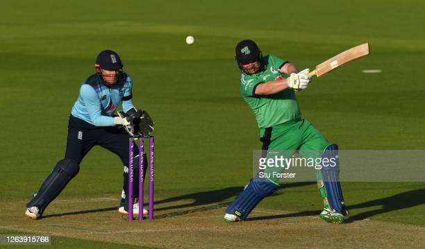 Paul Stirling of Ireland hits out watched on by Jonny Bairstow of England during the Third One Day International between England and Ireland in the...
