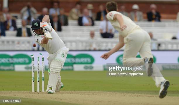 Paul Stirling of Ireland is bowled by Chris Woakes of England during the third day of the Specsavers Test Match between England and Ireland at Lord's...
