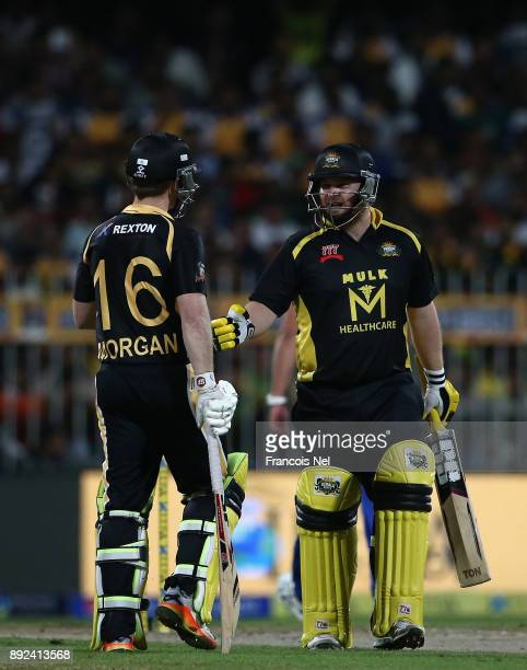 Paul Stirling of Kerela Kings speaks to Eoin Morgan of Kerela Kings during the T10 League match between Bengal Tigers and Kerala Kings at Sharjah...