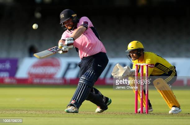 Paul Stirling of Middlesex bats as wicketkeeper Lewis McManus of Hampshire looks on during the Vitality Blast match between Middlessex and Hampshire...