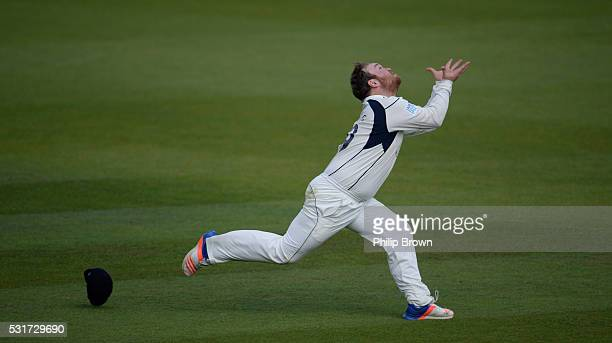 Paul Stirling of Middlesex catches Steven Davies during day two of the Specsavers County Championship Division One match between Surrey and Middlesex...