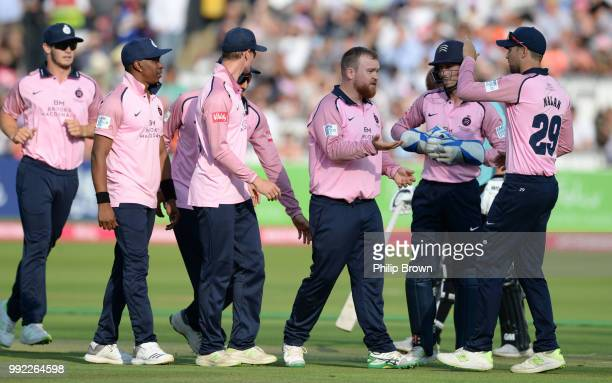 Paul Stirling of Middlesex is congratulated after the dismissal of Will Jacks of Surrey during the Middlesex v Surrey Vitality T20 Blast match at...