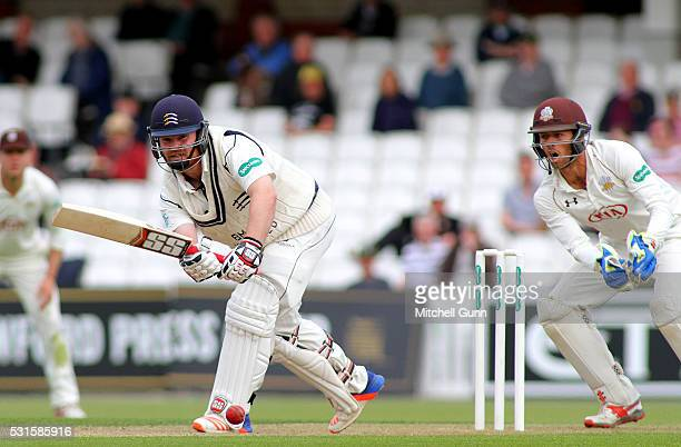 Paul Stirling of Middlesex plays a shot as wicketkeeper Ben Foakes of Surrey looks on during the Specsavers County Championship Division One match...