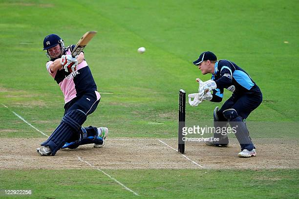 Paul Stirling of Middlesex smashes the ball towards the boundary as Ben Brown of Sussex watches during the Clydesdale Bank 40 match between Middlesex...