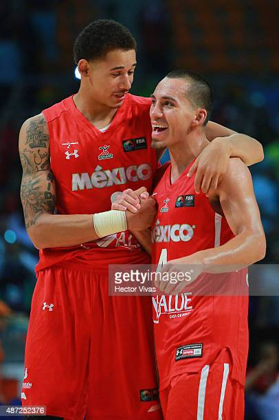 Paul Stoll and Juan Toscano of Mexico celebrates with his teammate during a second stage match between Venezuela and Mexico as part of the 2015 FIBA...