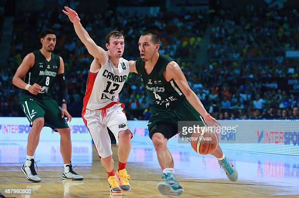 Paul Stoll of Mexico dribbles the ball against Brady Heslip of Canada during a third place match between Canada and Mexico as part of the 2015 FIBA...