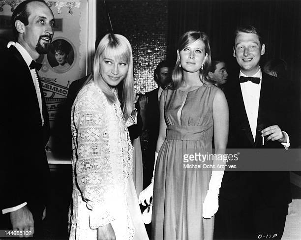 Paul Stookey and Mary Travers of the folk group 'Peter Paul Mary' pose for a portrait with director Mike Nichols circa 1965