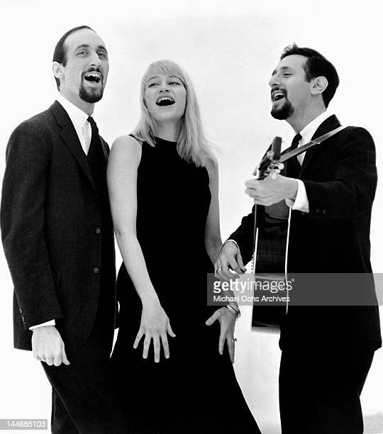 Paul Stookey Mary Travers and Peter Yarrow of the folk group 'Peter Paul Mary' pose for a portrait circa 1965