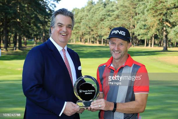 Paul Streeter of England is presented with the trophy by His Grace the Duke of Bedford on Day Three of the Travis Perkins Senior Masters at Woburn...
