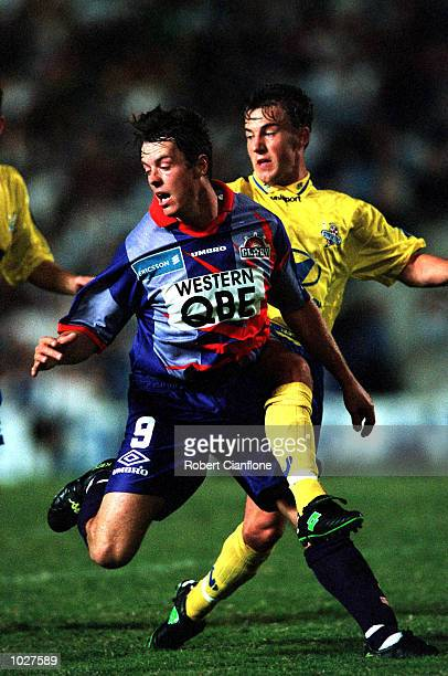 Paul Strudwick of Perth Glory gets his kick away as his opponent attempts to tackle during the NSL match between the Brisbane Strikers and Perth...