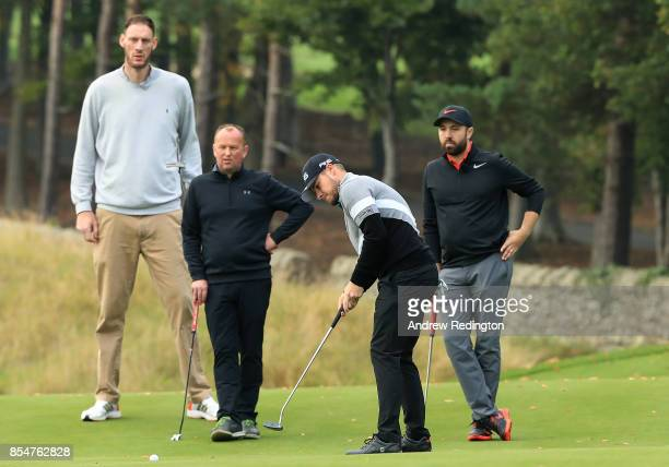 Paul Sturgess Matt Ulyett and Rick Shiels look on as Tyrell Hatton of England putts during the pro am ahead of the British Masters at Close House...