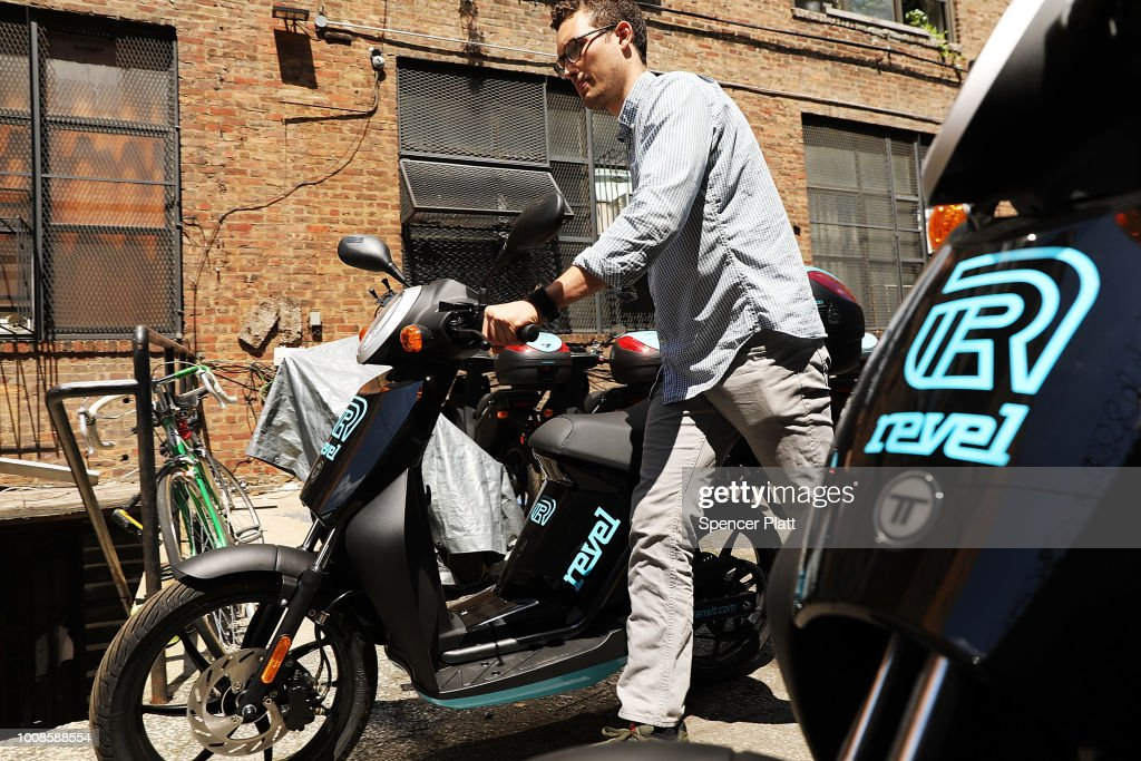 Paul Suhey, co-founder of the electric moped start-up Revel, walks a