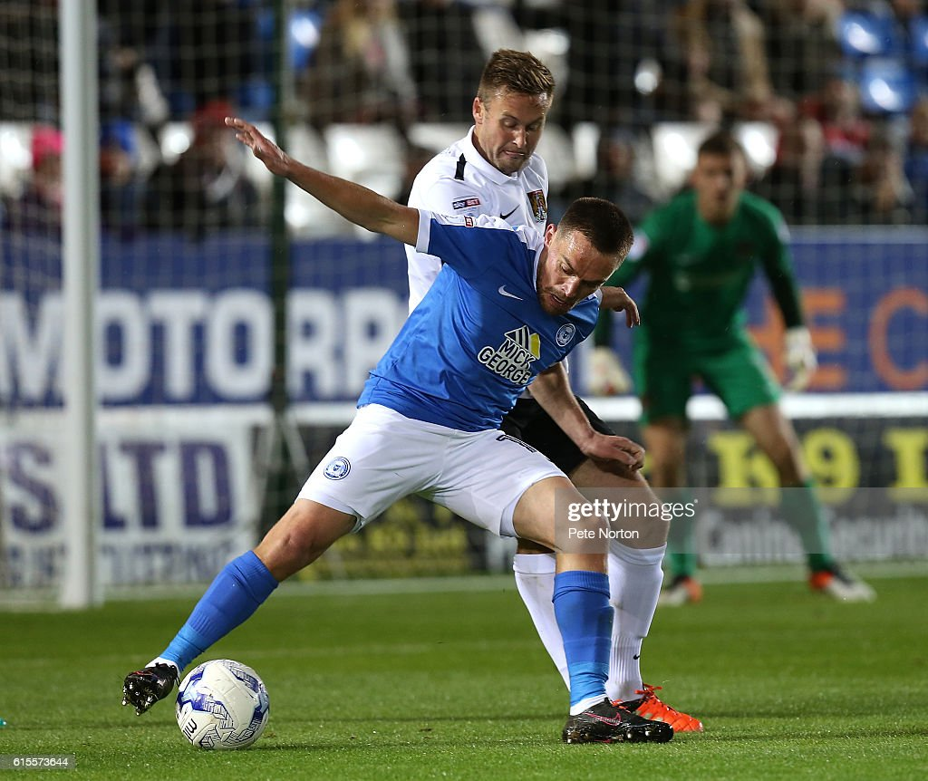 Paul Taylor of Peterborough United controls the ball under pressure from Joel Byrom of Northampton Town during the Sky Bet League One match between Peterborough United and Northampton Town at ABAX Stadium on October 18, 2016 in Peterborough, England.