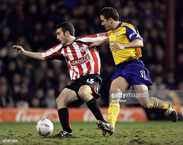 Paul Telfer of Southampton tries to tackle Kevin O'Connor of Brentford during the FA Cup Fifth round Replay between Brentford v Southampton at...
