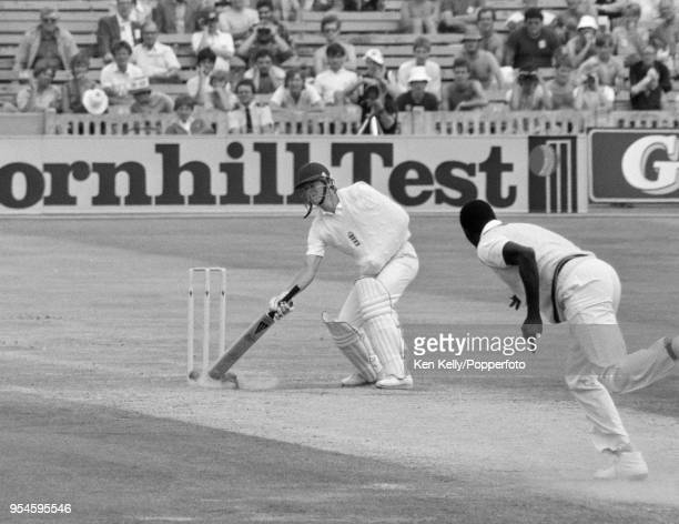 Paul Terry of England batting onehanded with his arm in a sling tries to defend his wicket but is bowled for 7 runs by Joel Garner of West Indies...
