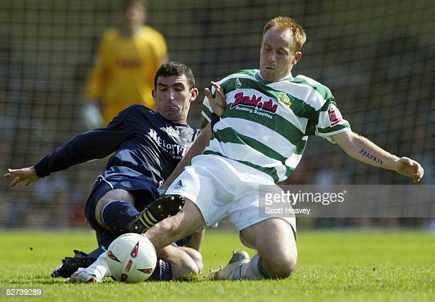 Paul Terry of Yeovil slides in on Kevin Maher of Southend during the Coca Cola Championship Division Two match between Southend United and Yeovil at...