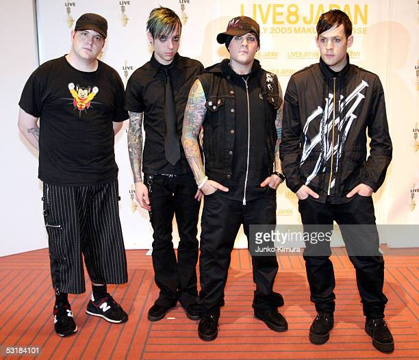 Paul Thomas Billy Martin Benji and Joel Madden of Good Charlotte poses backstage during Live 8 Japan at Makuhari Messe on July 2 2005 in Chiba east...
