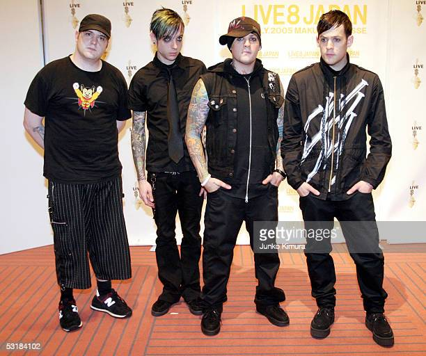 Paul Thomas Billy Martin Benji and Joel Madden of Good Charlotte pose backstage during Live 8 Japan at Makuhari Messe on July 2 2005 in Chiba east of...