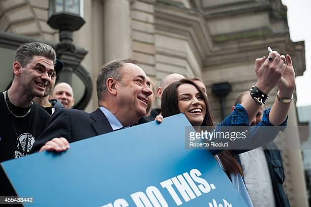 Paul Thomson Alex Salmond and Amy MacDonald make a selfie during a photocall to present the event A Night For Scotland a concert for 'Yes Scotland'...
