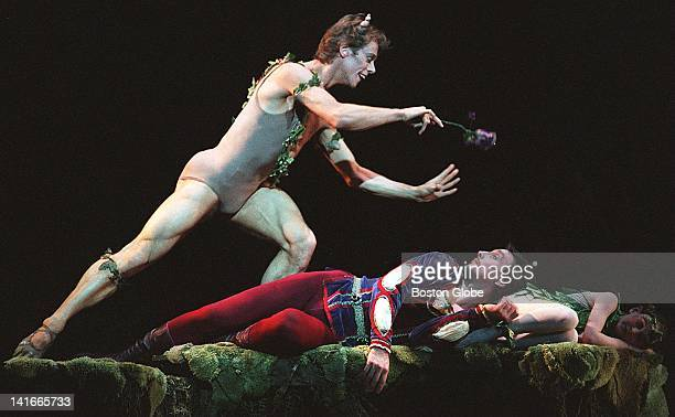 Paul Thrussell as Puck casts a spell on Victor Plotnikov as Lysander in Boston Ballet's 'A Midsummer Night's Dream'