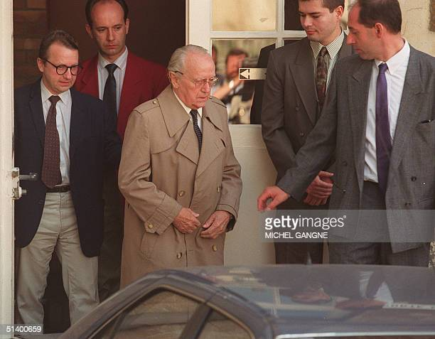 Paul Touvier former head of Nazi's militia in wartime in Lyon leaves the court of appeals of Versailles accompagned by his son Pierre 29 June 1993...