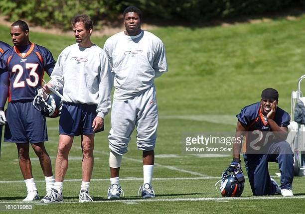 Paul Toviessi second from right on the sidlines during the Broncos minicamp at the Dove Valley facility