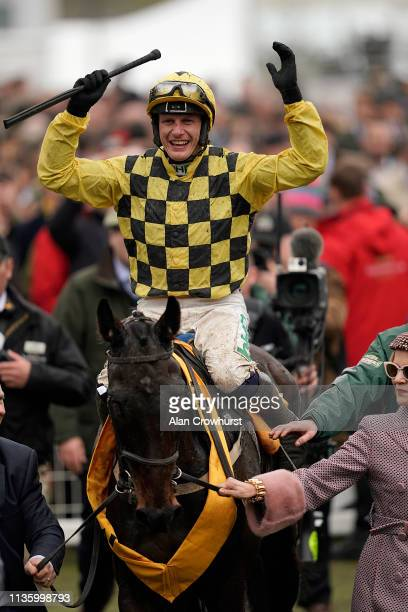 Paul Townend celebrates after riding Al Boum Photo to win The Magners Cheltenham Gold Cup Steeple Chase on Gold Cup Day at Cheltenham Racecourse on...