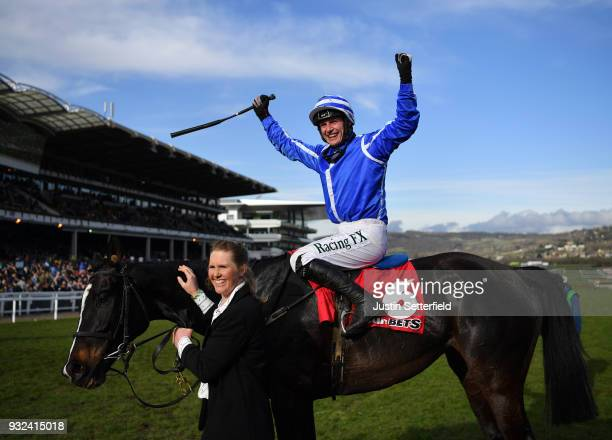 Paul Townend celebrates on Penhill after victory in the Sun Bets StayersÕ Hurdle at Cheltenham Racecourse on March 15 2018 in Cheltenham England