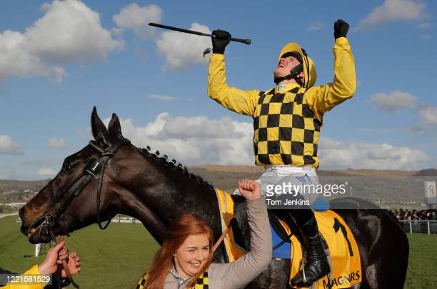 Paul Townend celebrates victory on Al Boum Photo after they won the Gold Cup during day four of the Cheltenham National Hunt Racing Festival at...