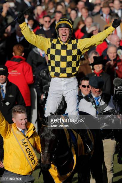 Paul Townend celebrates victory on Al Boum Photo as they enter the winners enclosure after they won the Gold Cup during day four of the Cheltenham...