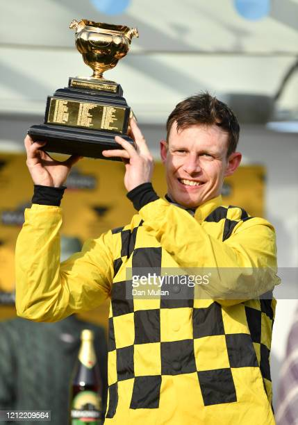 Paul Townend celebrates winning the Magners Cheltenham Gold Cup Chase at Cheltenham Racecourse on March 13, 2020 in Cheltenham, England.