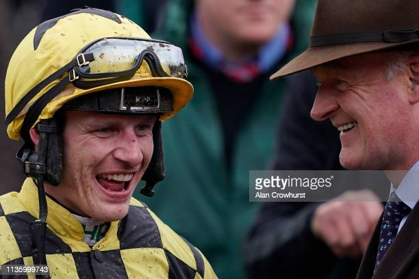 Paul Townend chats with trainer Willie Mullins after riding Al Boum Photo to win The Magners Cheltenham Gold Cup Steeple Chase on Gold Cup Day at...
