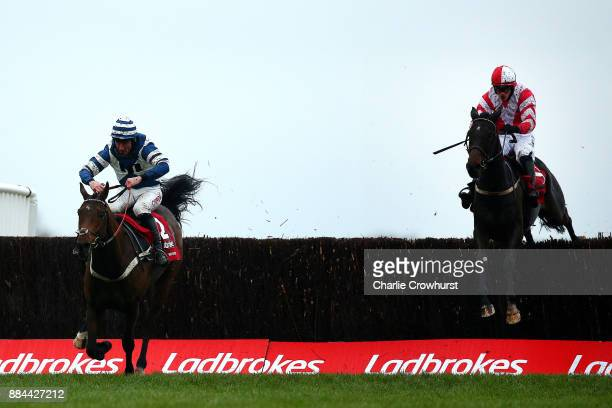 Paul Townend rides Total Recall to beat Davy Russell on Whisper to win The Ladbrokes Trophy Steeple Chase at Newbury Racecourse on December 2 2017 in...