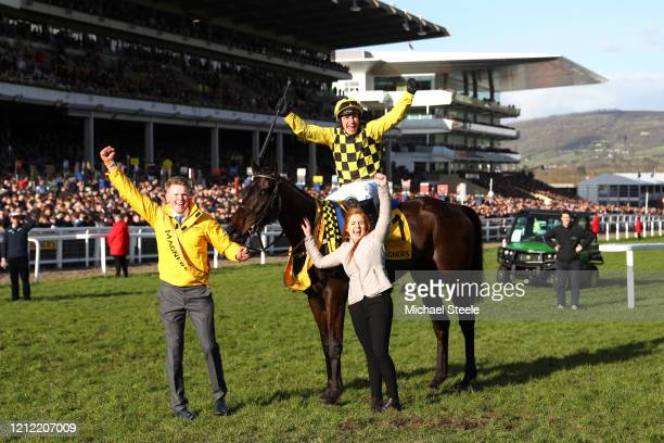 Paul Townend riding Al Boum Photo celebrates winning the Magners Cheltenham Gold Cup Chase at Cheltenham Racecourse on March 13, 2020 in Cheltenham,...